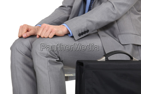 man in a suit sitting and