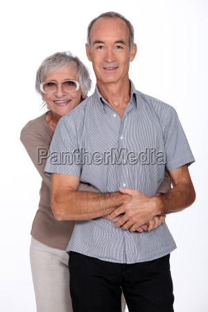 affectionate senior couple stood in the