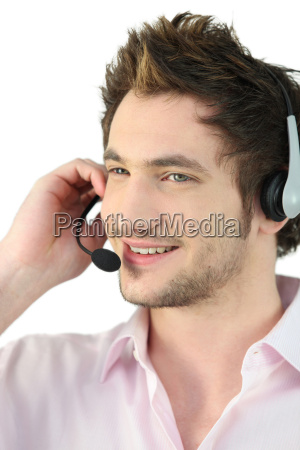 young man with headset speaking