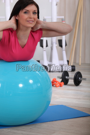 woman working out with the help
