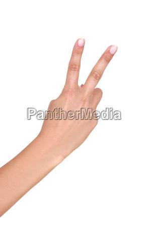 hand haelt zwei finger hoch