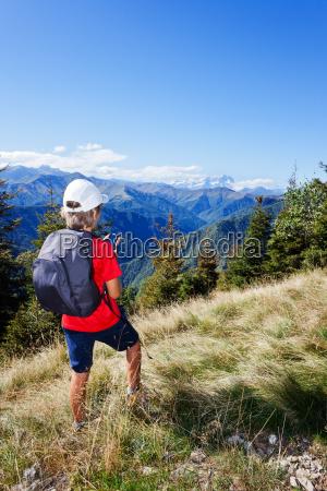 young boy standing along a mountain
