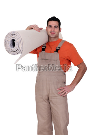 craftsman holding a carpet