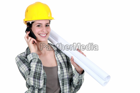 female builder with plans and mobile