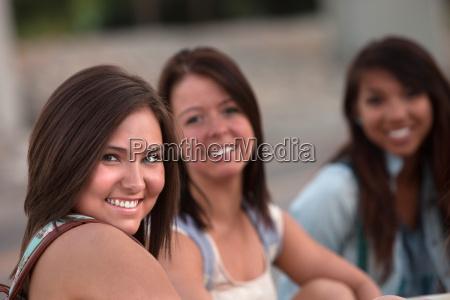 three cute teen girls sitting