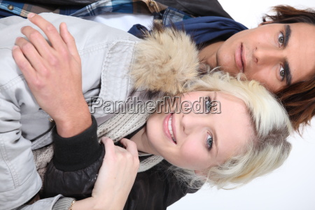 attractive couple wearing winter coats