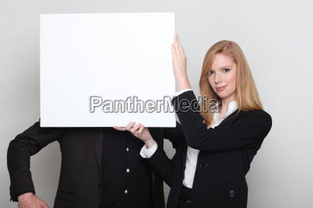 woman covering mans face with blank
