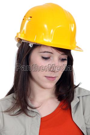 a sad female construction worker