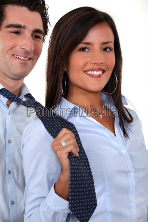 a businesswoman pulling her colleague by
