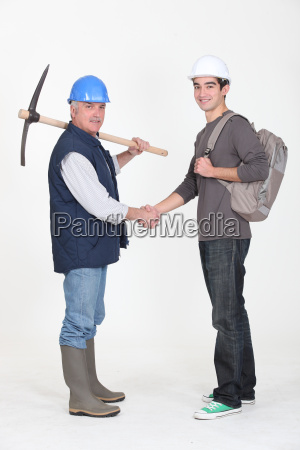 experienced tradesman meeting his new apprentice