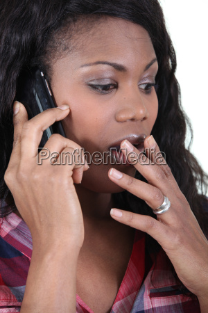 woman in shock on a cellphone