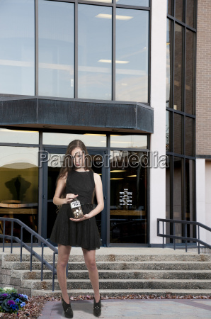 woman holding her college fund