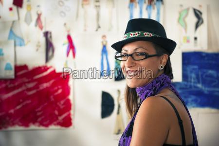 portrait of happy woman working as