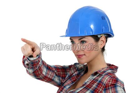 happy craftswoman pointing