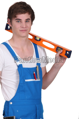 young man with a spirit level