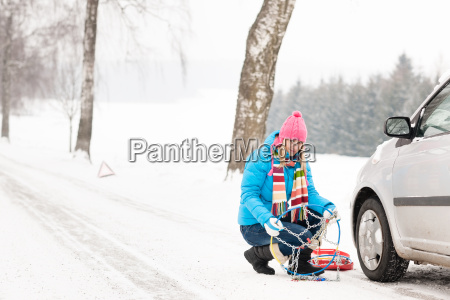 snow tire chains winter car woman