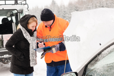 woman fill document broken car snow