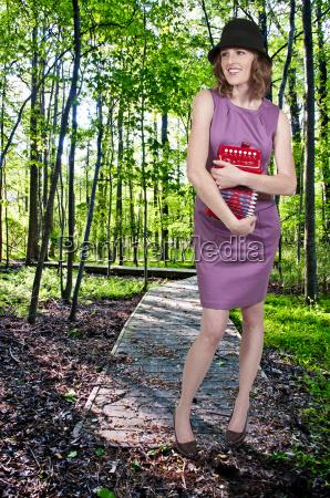woman holding accordian