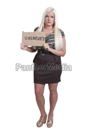 woman holding an unemployment sign