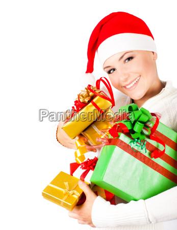 happy santa maedchen mit weihnachtsgeschenken