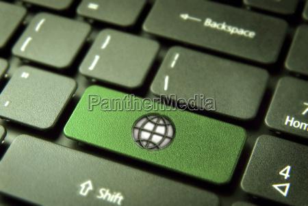 go green keyboard key with globe