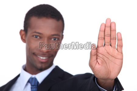 businessman holding his hand in a