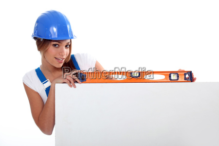 pretty worker girl showing her tool