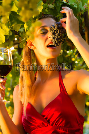 woman with wine glass in rebstock