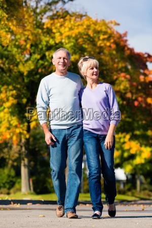 seniors in the autumn on walk