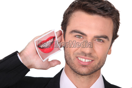 businessman listening to a photo of