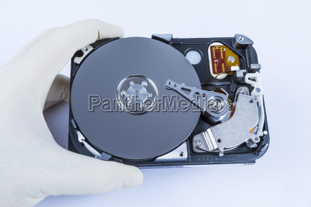 technician with open hard disk
