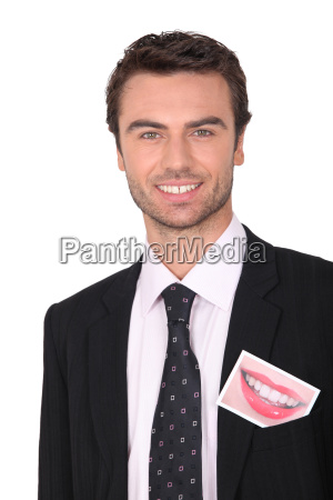 smiling businessman with a photo of