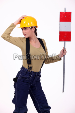 female road worker with sign