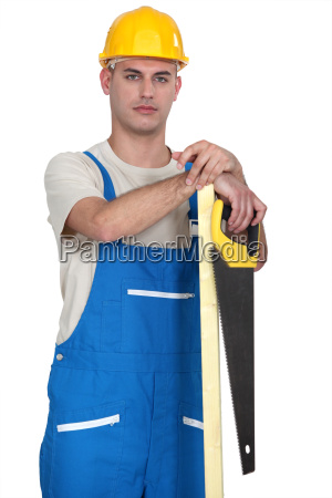 builder with timber and a saw