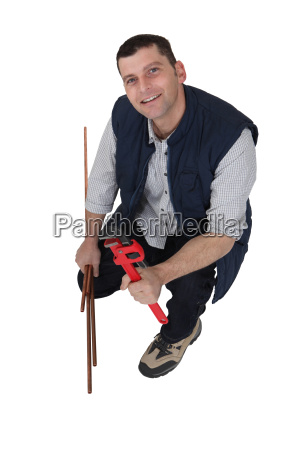 plumber with a wrench and copper