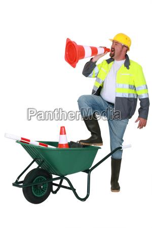 builder shouting through cone