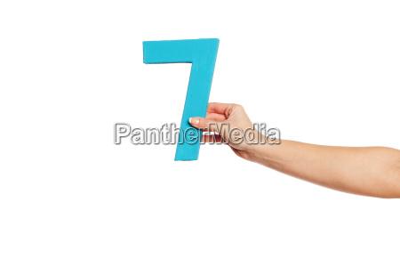 hand haelt die nummer sieben von