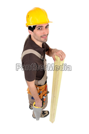 builder with wood and saw