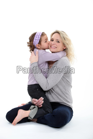 mother holding daughter in her arms