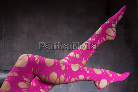 woman legs in pink tights