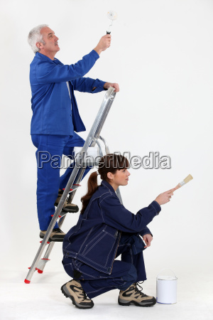 female painter with mature instructor