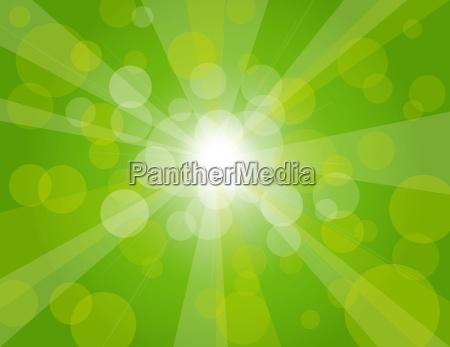 sonnenstrahlen auf gruenem hintergrund illustration