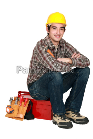 portrait of young craftsman sitting on