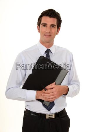 confident businessman holding folder