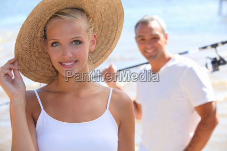 pretty blonde with sun hat and