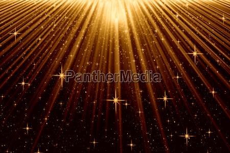 stimmungsvoller hintergrund mit lichtstrahlen und sternen