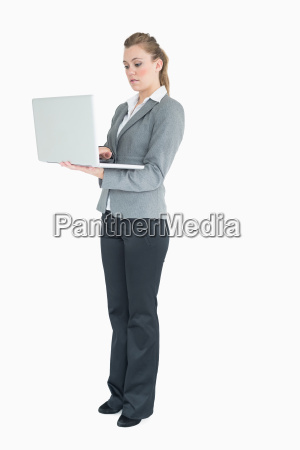businesswoman typing on the laptop while