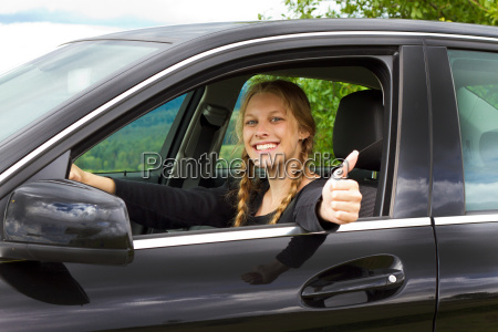 car driver with thumbs up
