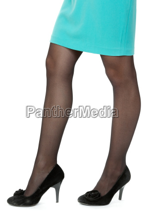 a womans legs with black high