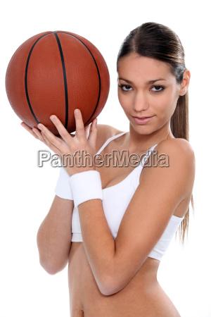 woman doing gym with basketball ball